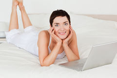 Woman posing with a laptop Royalty Free Stock Images