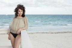 Woman posing on a lifeguard hut Royalty Free Stock Photography