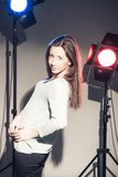 Woman posing in light flashes Royalty Free Stock Image