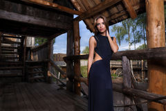 Woman posing on log house Royalty Free Stock Image