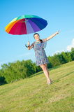 Woman posing on nature with color umbrella Stock Photos