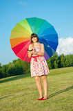 Woman posing on nature with color umbrella Stock Image