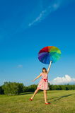 Woman posing on nature with color umbrella Royalty Free Stock Images