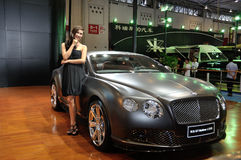 Woman posing near car at Chengdu Motor Show 2012. The car and model of The 2012 China Chengdu International Automobile Exhibition.The exhibition is held in 2012 Royalty Free Stock Image
