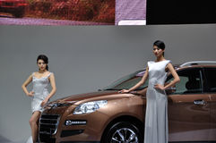 Woman posing near car at Chengdu Motor Show 2012. The car and model of The 2012 China Chengdu International Automobile Exhibition.The exhibition is held in 2012 Royalty Free Stock Photo