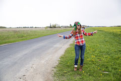Woman posing near countryside road on field Stock Image