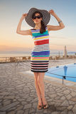 Woman posing near a hotel Stock Image