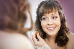 Woman posing near the mirror Stock Photos