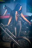 Woman Posing Near Motorbikes, Man Playing Billiards Stock Photography