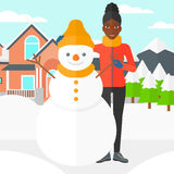 Woman posing near snowman. Royalty Free Stock Images