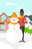 Woman posing near snowman. Stock Photography