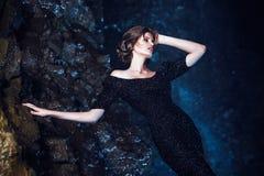 Woman posing near waterfall. stock photography
