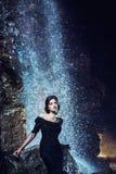 Woman posing near waterfall. royalty free stock image