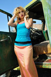 Woman posing next to an old time auto Royalty Free Stock Photography