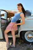 Woman posing next to an old time auto Royalty Free Stock Photo