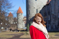 Woman posing in old town of Tallinn, Estonia Stock Image