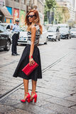 Woman posing outside Byblos fashion shows building for Milan Women's Fashion Week 2014 Stock Image