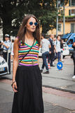 Woman posing outside Gucci fashion shows building for Milan Women's Fashion Week 2014 Royalty Free Stock Image