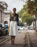 Woman posing outside Gucci fashion shows building for Milan Women's Fashion Week 2014 Royalty Free Stock Image