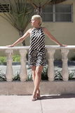 Woman posing outside in a pattern dress Royalty Free Stock Image