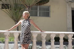 Woman posing outside in a pattern dress Royalty Free Stock Photos