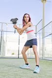 Woman posing in paddle tennis court Stock Photography