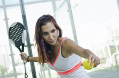 WOman posing in paddle tennis court Stock Image
