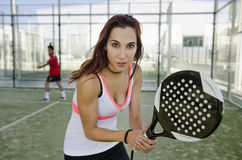 Woman posing in paddle tennis court Stock Photos