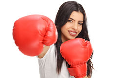Woman posing with a pair of boxing gloves Stock Images