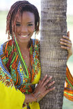 Woman posing by a palm tree Royalty Free Stock Image
