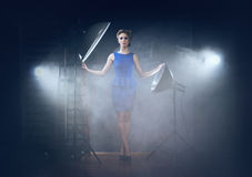 A woman posing in a photostudio Royalty Free Stock Image