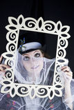 Woman posing with picture frame Stock Photo
