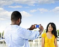 Woman posing for picture near boats Royalty Free Stock Images