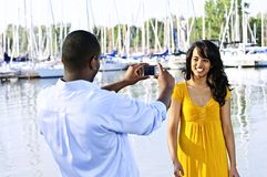 Woman posing for picture near boats Royalty Free Stock Photos