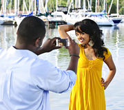 Woman posing for picture near boats Stock Photos