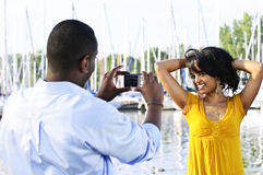Woman posing for picture near boats Royalty Free Stock Photography