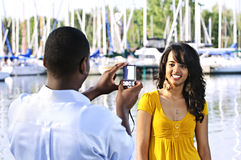 Woman posing for picture near boats Stock Photography