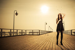 Woman posing on pier at sunrise Royalty Free Stock Photos