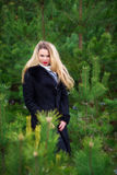 Woman posing in pines Stock Photography