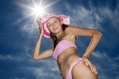 Woman posing in pink bikini again blue sky with Stock Photography