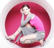 Woman posing in pink circle Royalty Free Stock Image
