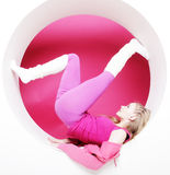 Woman posing in pink circle Stock Images
