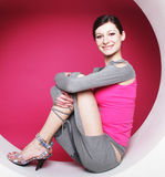 Woman posing in pink circle Royalty Free Stock Photo