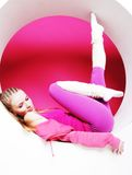Woman posing in pink circle Stock Photos