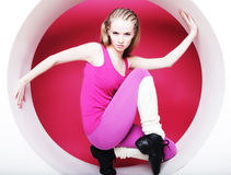 Woman posing in pink circle Stock Photography