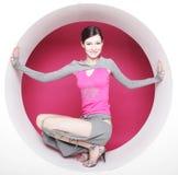 Woman posing in pink circle Royalty Free Stock Photos