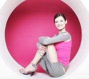 Woman posing in pink circle Stock Photo