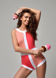 Woman posing in pink and red modern bikini underwear vest happy Royalty Free Stock Photos