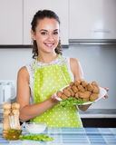 Woman posing with plate of deep-fried kroketten Stock Image