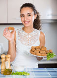 Woman posing with plate of deep-fried kroketten Royalty Free Stock Image